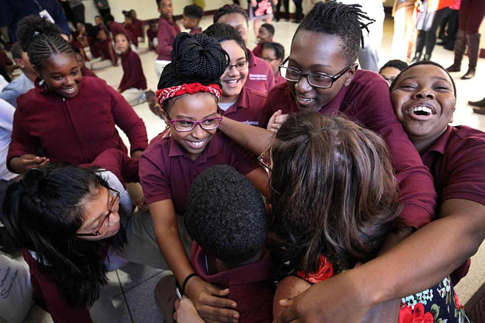 Cambridge, MA., 10/16/2018 Librarian Jennifer Gordon is embraced by her students after she received a Milken Educator Award -- a prize that comes with $25,000--during a surprise ceremony at the Benjamin Banneker Charter Public School. Suzanne Kreiter/Globe staff